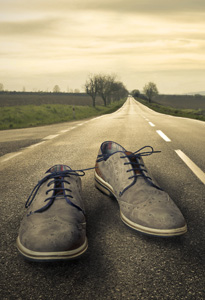 Image of a pair of shoes on a road on the Mindfulness Now Scotland page