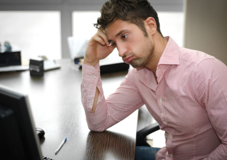 Image of a young man at a desk on the anxiety attacks page