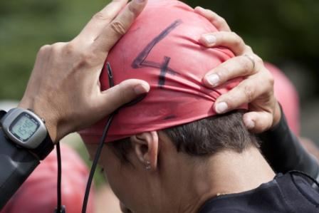 image of a triathlete about to swim on performance coaching page