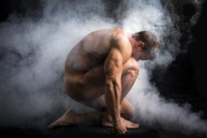performance coaching page image of muscular man crouching down
