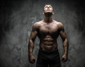 image of a strong muscular male on performance coaching page