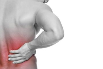 Image of a Man holding his back in pain - Back Pain