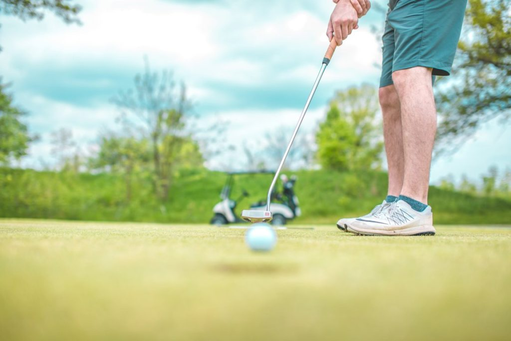 image of a man putting on a golf course on the putting yips page